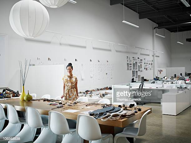 Designer standing at conference table