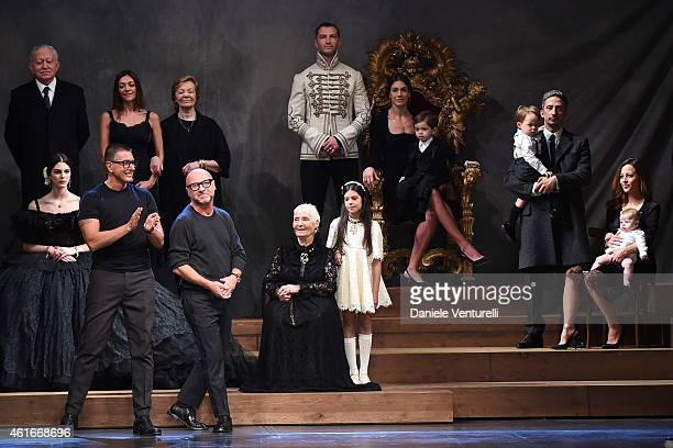 Designer Stefano Gabbana and Domenico Dolce acknowledges the applause of the audience after the DolceGabbana as a part of Milan Menswear Fashion Week...