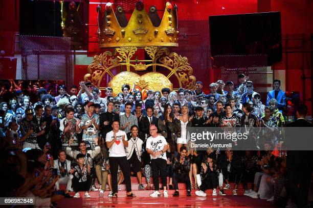 Designer Stefano Gabbana and Domenico Dolce aknowledge the applause of the public after the Dolce Gabbana show during Milan Men's Fashion Week...