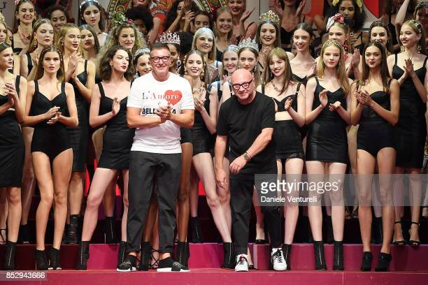 Designer Stefano Gabbana and Domenico Dolce aknowledge the applause of the public after the Dolce Gabbana show during Milan Fashion Week...