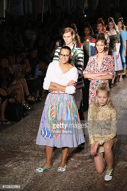 Designer Stella Jean aknoledges the applause of the public after the Stella Jean show during Milan Fashion Week Spring/Summer 2017 on September 25,...