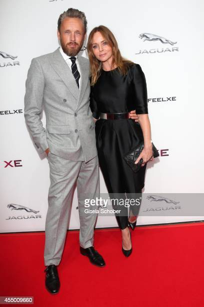 Designer Stella McCartney and her husband Alasdhair Willis attend the new Jaguar XE World Premiere at Earls Court on September 8 2014 in London...