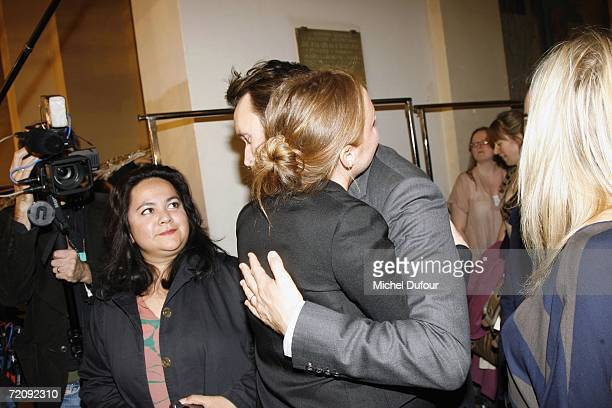Designer Stella McCartney hugs her husband Alasdhair Willis the Stella McCartney Fashion Show as part of Paris Fashion Week Spring/Summer 2007 on...
