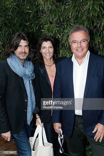 Designer Stephane Rolland Alain Afflelou with his wife Christine sighting at the Roland Garros Tennis French Open 2013 Day 15 on June 9 2013 in Paris...