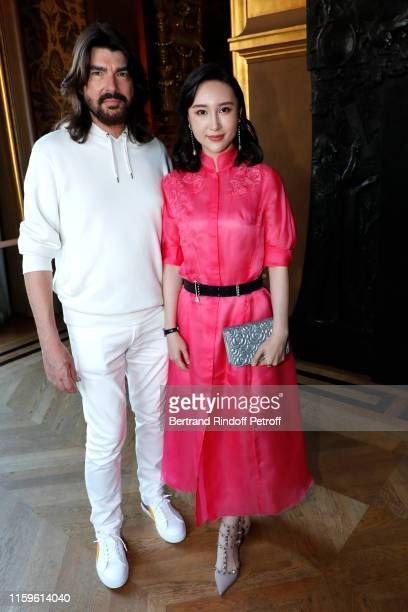 Designer Stephane Rolland and Li Wei pose after the Stephane Rolland Haute Couture Fall/Winter 2019 2020 show as part of Paris Fashion Week on July...