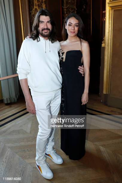 Designer Stephane Rolland and Sofia Essaidi pose after the Stephane Rolland Haute Couture Fall/Winter 2019 2020 show as part of Paris Fashion Week on...