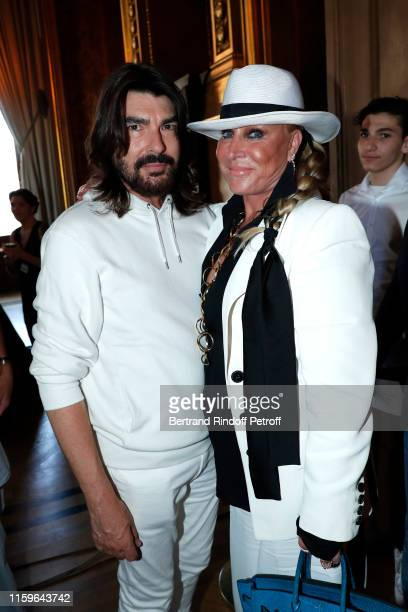 Designer Stephane Rolland and Suzanne Saperstein pose after the Stephane Rolland Haute Couture Fall/Winter 2019 2020 show as part of Paris Fashion...