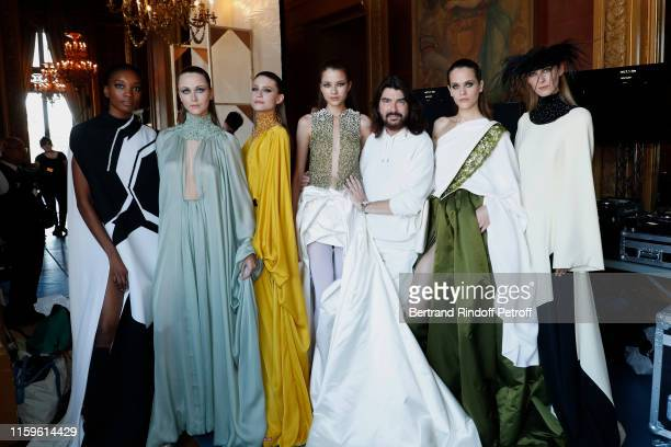 Designer Stephane Rolland poses with his Models after the Stephane Rolland Haute Couture Fall/Winter 2019 2020 show as part of Paris Fashion Week on...
