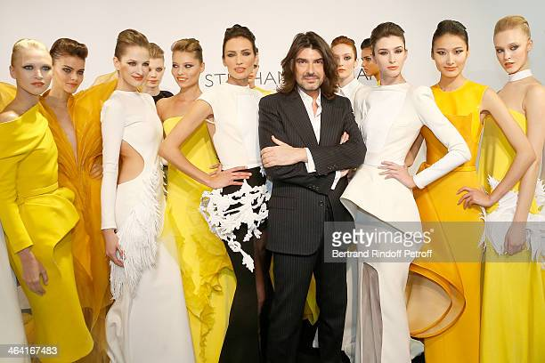 Designer Stephane Rolland poses with models including Nieves Alvarez on his right after his show as part of Paris Fashion Week Haute Couture...