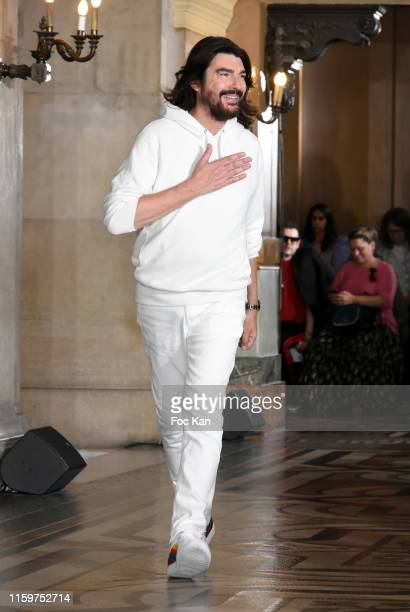 Designer Stephane Rolland walks the runway during the Stephane Rolland Haute Couture Fall/Winter 2019 2020 show as part of Paris Fashion Week on July...