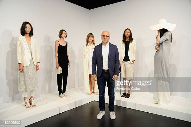 Designer Steven Alan poses with models on the runway at the Steven Alan presentation during MercedesBenz Fashion Week Spring 2014 at The Box at...