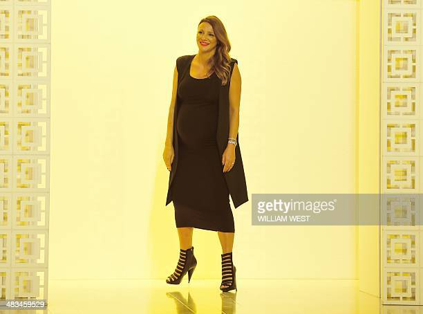 Designer Sue Di Chio acknowledges the applause after a parade of her label Suboo at Fashion Week Australia in Sydney on April 9 2014 The fourday...