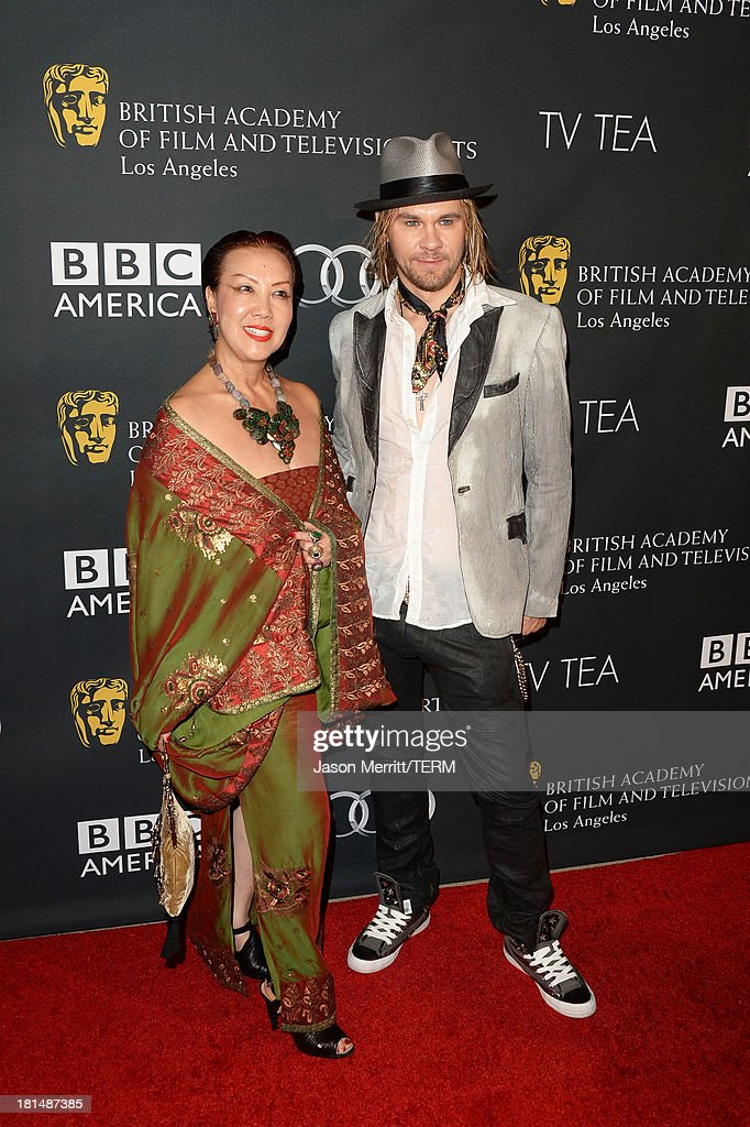 Designer Sue Wong (R) and actor Kayd Currier attend the BAFTA LA TV Tea 2013 presented by BBC America and Audi held at the SLS Hotel on September 21, 2013 in Beverly Hills, California.