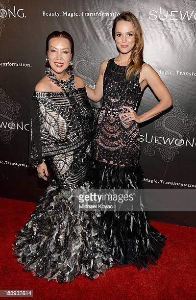 Designer Sue Wong and actress Erin Cahill attend Sue Wong 'Jazz Babies' Spring 2014 Runway Show on October 9 2013 in Los Angeles California