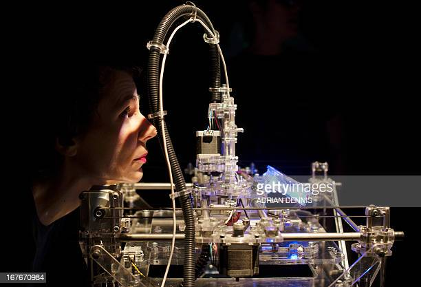 Designer Susana Soares looks at a 3D printer during a photocall for the 'Insects au Gratin' exhibition at The Wellcome Collection in London on April...