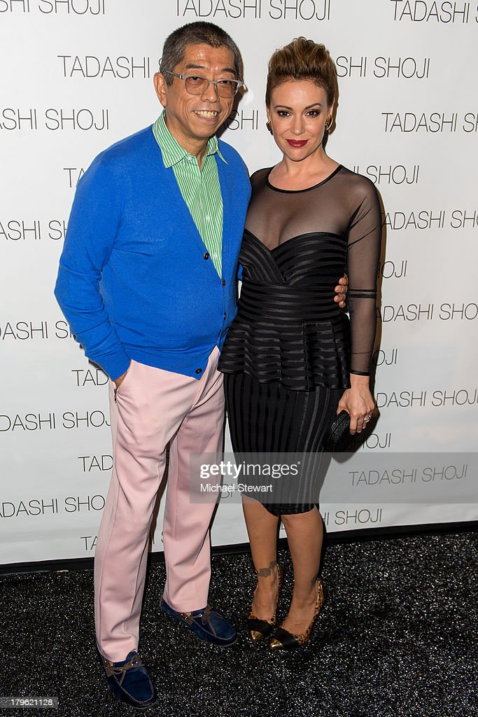 Designer Tadashi Shoji (L) and actress Alyssa Milano attend the Tadashi Shoji show during Spring 2014 Mercedes-Benz Fashion Week at The Stage at Lincoln Center on September 5, 2013 in New York City.