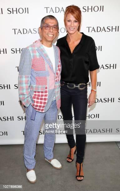 Designer Tadashi Shoji and actress Angie Everhart pose backstage for the Tadashi Shoji show during New York Fashion Week The Shows at Gallery I at...