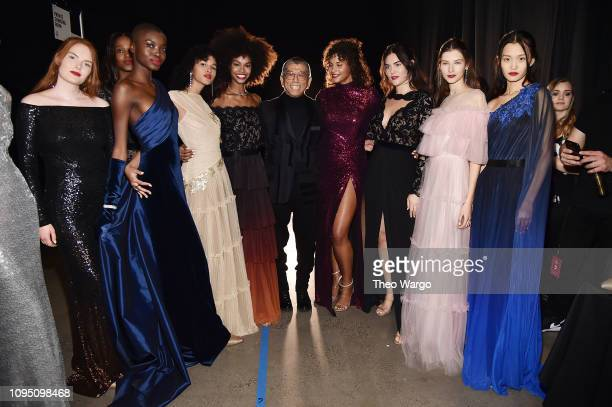 Designer Tadashi Shoji poses with models backstage for Tadashi Shoji FW'19 Fashion Show during New York Fashion Week The Shows at Gallery I at Spring...