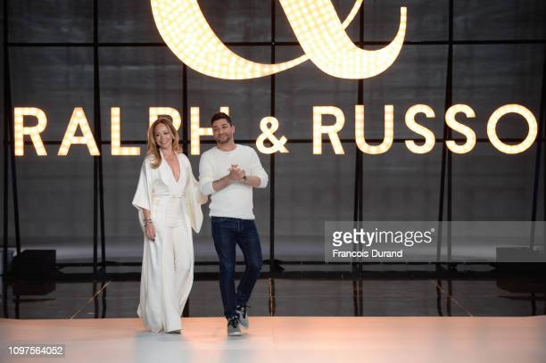 Designer Tamara Ralph and Michael Russo salute the public after the Ralph Russo Spring Summer 2019 show as part of Paris Fashion Week on January 21...