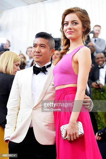 Designer Thakoon Panichgul and actress Emma Stone attend the Charles James Beyond Fashion Costume Institute Gala at the Metropolitan Museum of Art on...