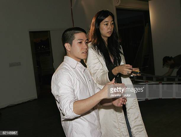 Designer Thakoon Panichgul gets the set ready before the presentation of the Thakoon Fall 2005 show during Olympus Fashion Week at DriveIn Studios...