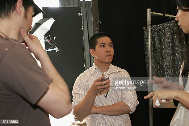 Designer Thakoon Panichgul stands backstage at the presentation of the Thakoon Fall 2005 show during Olympus Fashion Week at DriveIn Studios February...
