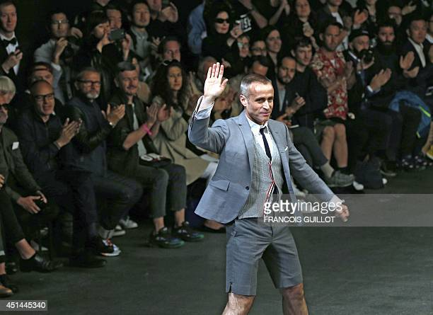 US designer Thom Browne acknowledges the public at the end of the Thom Browne men 2015 Spring/Summer readytowear collections show in Paris on June 29...