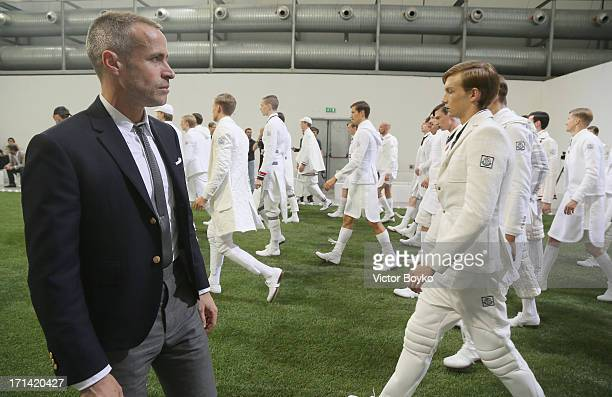 Designer Thom Browne look on during the Moncler Gamme Bleu rehearsal as part of Milan Fashion Week S/S 2014 on June 23 2013 in Milan Italy