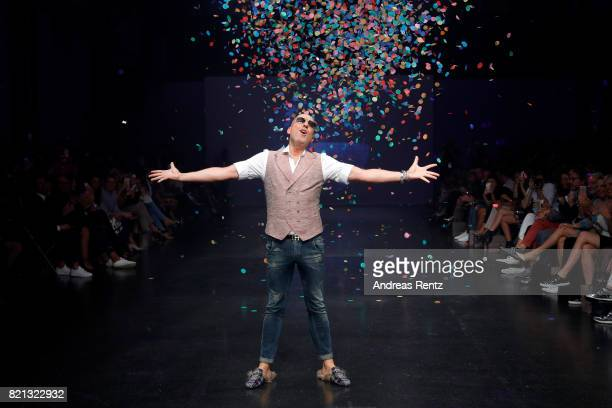 Designer Thomas Rath acknowledges the applause of the audience after his show during Platform Fashion July 2017 at Areal Boehler on July 23 2017 in...