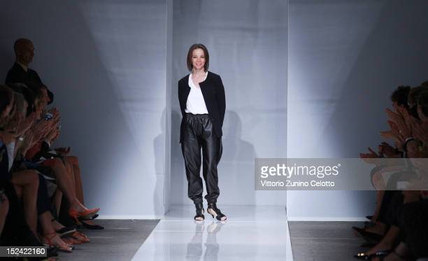 Designer Tia Cibani acknowledges the applause of the public after the Ports 1961 Spring/Summer 2013 fashion show as part of Milan Womenswear Fashion...