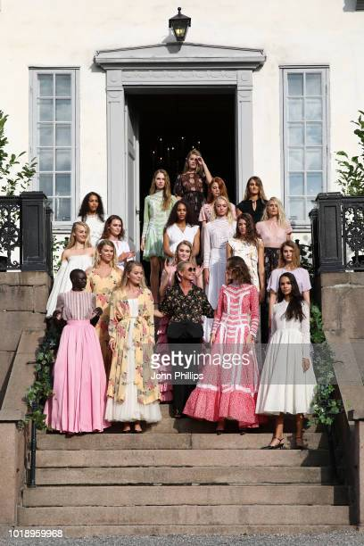 Designer Tine Mollatt and models acknowledge the applause of the audience after the byTiMo show during Oslo Runway SS19 at Oslo Ladegard on August 14...