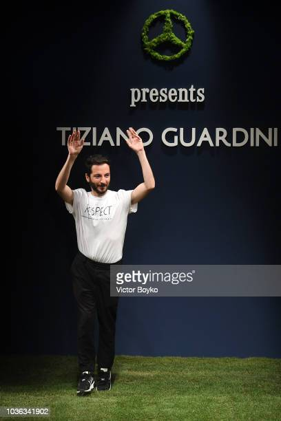 Designer Tiziano Guardini acknowledges the applause of the audience after his show during Milan Fashion Week Spring/Summer 2019 on September 20, 2018...