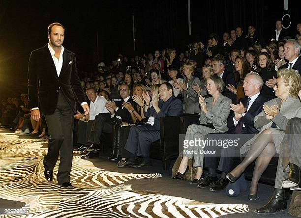 Designer Tom Ford acknowledges applause during Yves Saint Laurent Rive Gauche's spring/summer 2004 ready-to-wear collection on October 12, 2003 in...