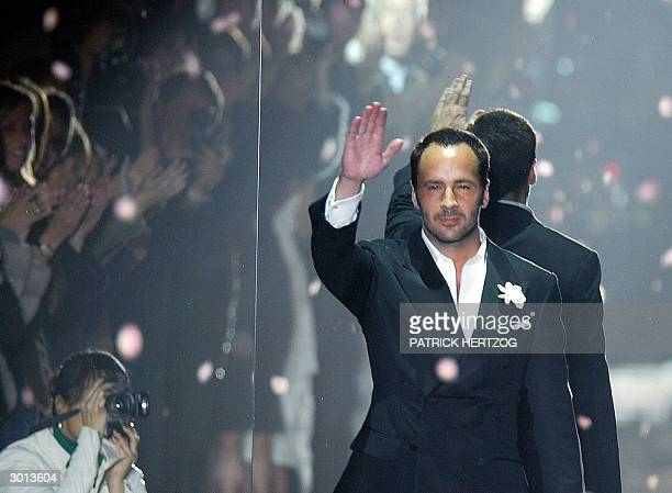 Designer Tom Ford aknowledges applauses on the catwalk at the end of his last Gucci Autumn/Winter 2004-2005 women' collection during Milan fashion...