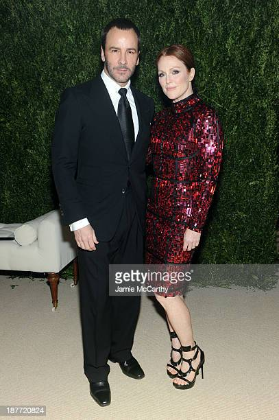 Designer Tom Ford and actress Julianne Moore attend CFDA and Vogue 2013 Fashion Fund Finalists Celebration at Spring Studios on November 11 2013 in...