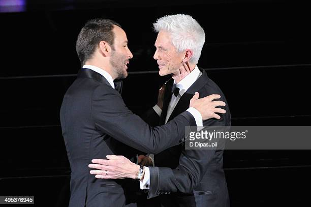 Designer Tom Ford and Richard Buckley appear onstage at the 2014 CFDA fashion awards at Alice Tully Hall, Lincoln Center on June 2, 2014 in New York...