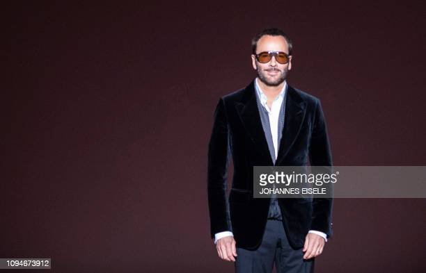 Designer Tom Ford appears on the runway after his fashion show at New York Fashion Week on February 6 2019 in midtown Manhattan New York City