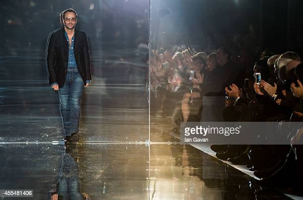 Designer Tom Ford appears on the runway after his TOM FORD show during London Fashion Week Spring Summer 2015 on September 15 2014 in London England
