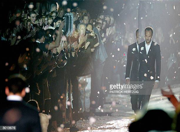 Designer Tom Ford leaves the catwalk at the end of his last Gucci Autumn/Winter 2004-2005 women' collection as part of Milan fashion week 25 February...
