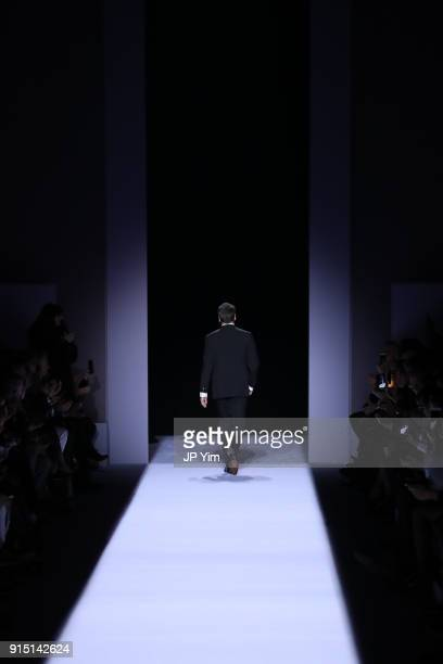 Designer Tom Ford walks the runway at the conclusion of his Tom Ford Mens FW18 Collection at Park Avenue Armory on February 6, 2018 in New York City.