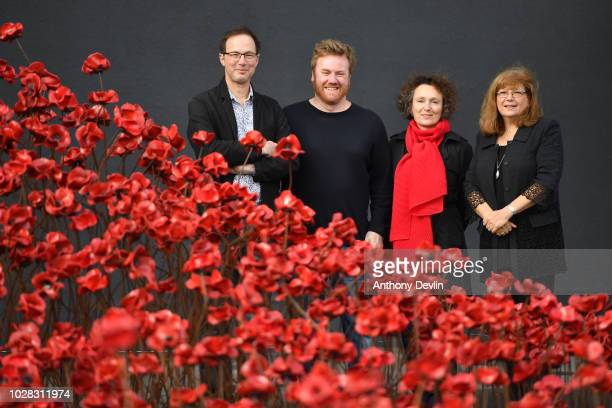 Designer Tom Piper artist Paul Cummins Jenny Waldman Director of 1418 NOW and Diane Lees DirectorGeneral of IWM pose with the iconic poppy sculpture...