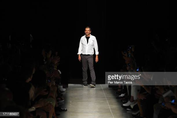 Designer Tomas Maier acknowledges the applause of the audience after the Bottega Veneta show during Milan Menswear Fashion Week Spring Summer 2014 on...