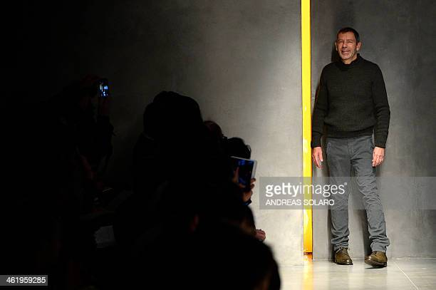 Designer Tomas Maier acknowledges the applause of the audience at the end of the show for fashion house Bottega Venata as part of Autumn/Winter 2014...