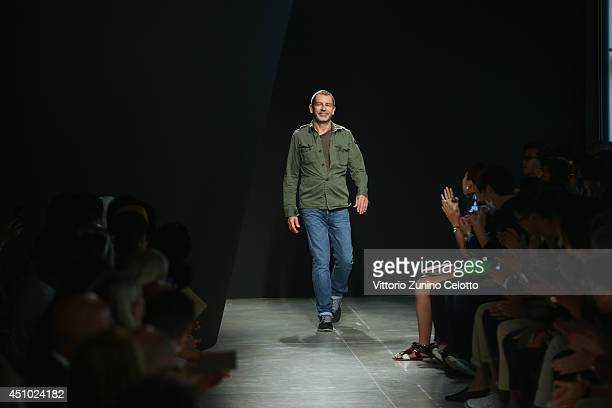 Designer Tomas Maier acknowledges the applause of the public after the Bottega Veneta show as part of Milan Fashion Week Menswear Spring/Summer 2015...