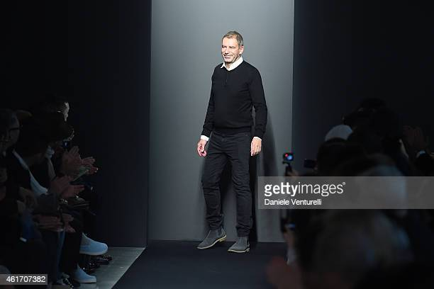 Designer Tomas Maier acknowledges the applause of the public after the Bottega Veneta show as a part of Milan Menswear Fashion Week Fall Winter...