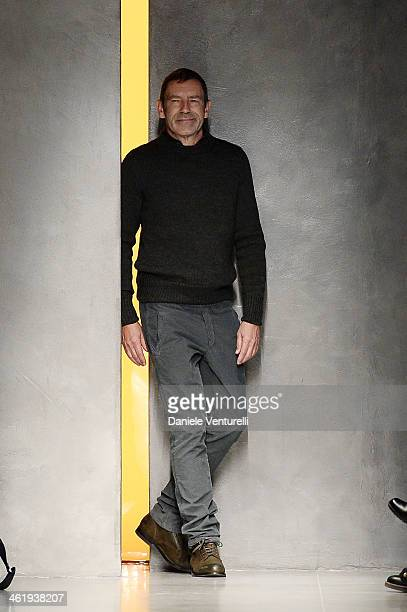 Designer Tomas Maier acknowledges the applause of the public after the Bottega Veneta show as a part of Milan Fashion Week Menswear Autumn/Winter...