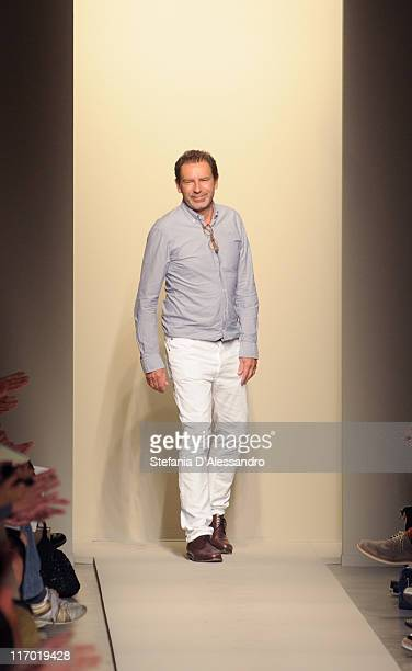Designer Tomas Maier acknowledges the audience at the end Bottega Veneta fashion show as part of Milan Fashion Week Menswear Spring/Summer 2012 on...