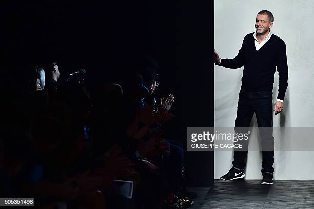 Designer Tomas Maier greets the audience at the end of the show for fashion house Bottega Veneta during the Men Fall Winter 2016 / 2017 collection...