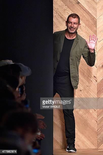 Designer Tomas Maier walks the runway during the Bottega Veneta Ready to Wear fashion show as part of Milan Men's Fashion Week Spring/Summer 2016 on...