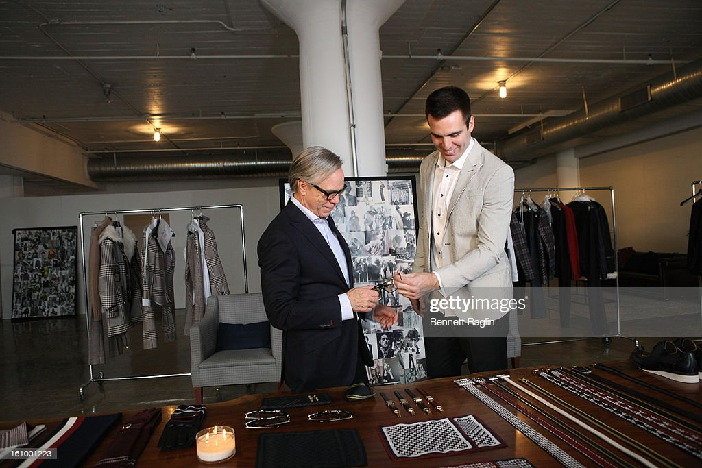 Designer Tommy Hilfiger and Baltimore Ravens Quarterback Joe Flacco get ready for Fashion Week at Hudson Studios on February 7, 2013 in New York City.
